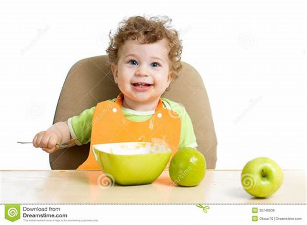 #Baby #Eating #By #Himself #Stock #Photo