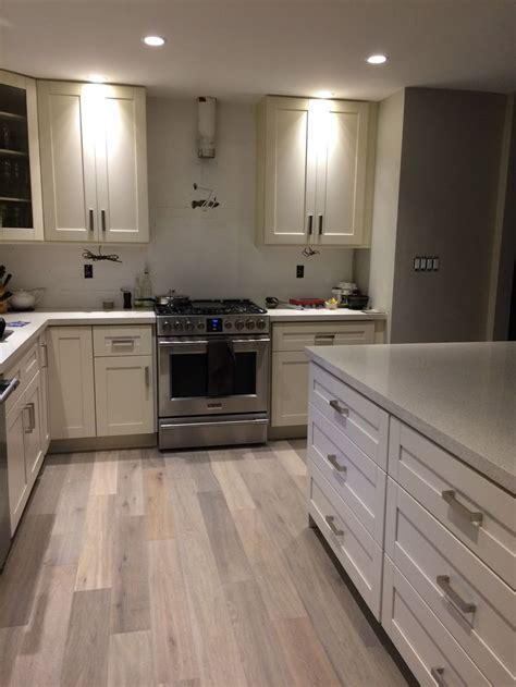 kitchen  milky white shaker cabinet frigidaire professional appliances vanilla taupe oak