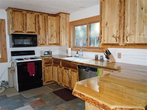 hand crafted custom cedar kitchen cabinets by king of the