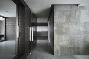 Ceramic Floor Tiles And Exposed Concrete Wall Modern House