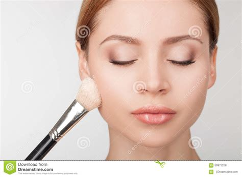 professional makeup artist professional makeup artist is treating attractive stock