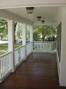 the covered front porch stained porch white rails new house outside porch