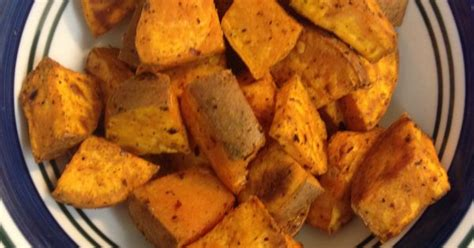 how to bake potatoes at 350 baked sweet potato chunks preheat oven to 350 cut sweet potato add coconut oil and whatever