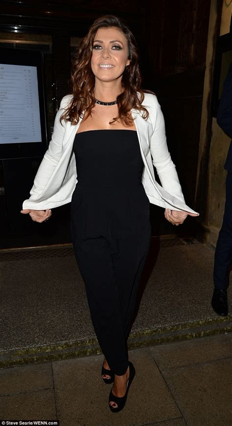 jumpsuit with blazer kym marsh looks stylish in strapless black jumpsuit and