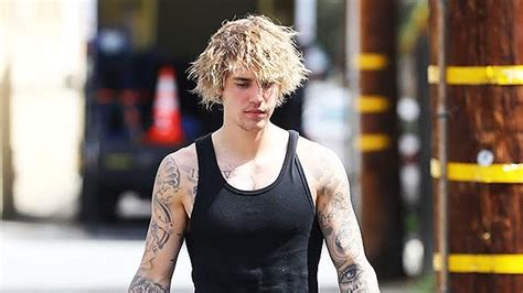 justin bieber shows  muscles  tight tank top