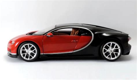 """This intricate 1:64 scale model from bburago is the perfect homage to such an impressive car, featuring authentic details across the body that follow every curve, nook and cranny of the original. Bburago New """"Plus"""" Series Bugatti Chiron • DiecastSociety.com"""