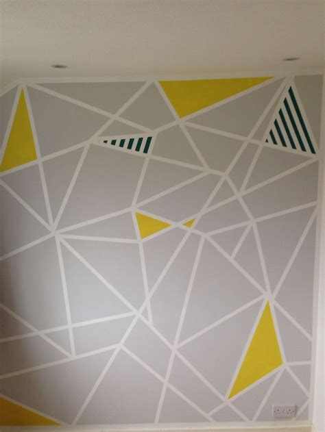 painting geometric shapes on walls geometric paint design on study feature wall frog tape and patience paint pinterest