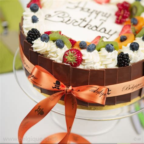 fresh fruit gateau celebration cake by belgique milk chocolate decoration available for