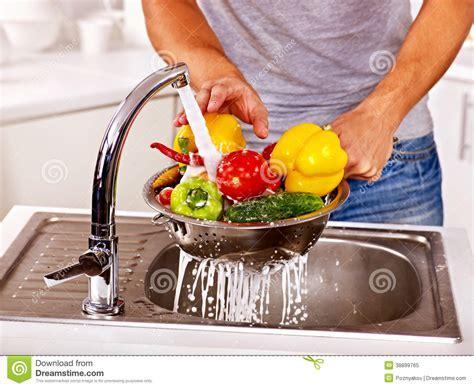 Man Washing Fruit At Kitchen. Stock Photo   Image: 38899765