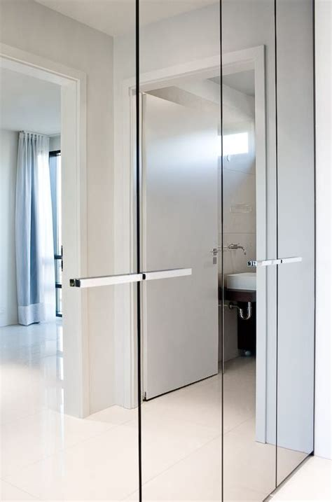Wardrobe Closet With Mirror Doors by Bright And Luminous Luxury Apartment By T18 With Mirrored