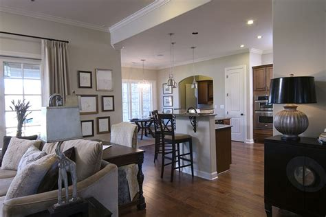 kitchen cabinets and backsplash regency homebuilders open concept living neutral 5893