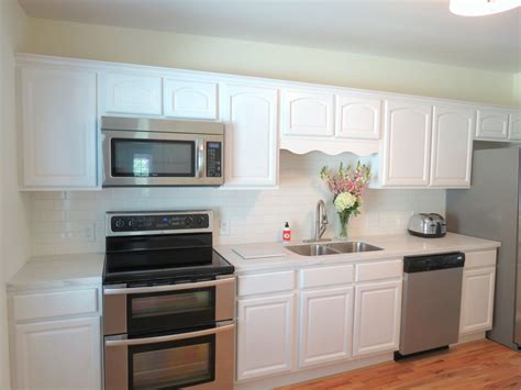 white painted kitchen cabinets jll design how to update your kitchen without breaking 7145