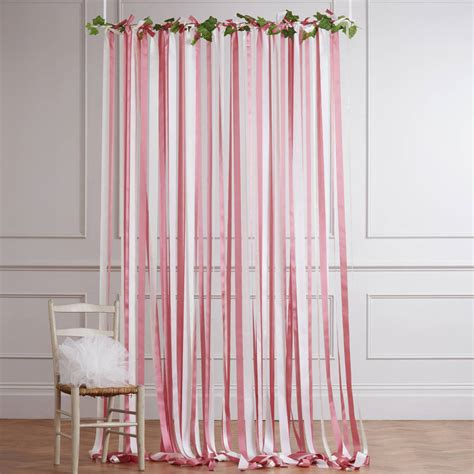 pink  cream ribbon backdrop  white pole  ivy