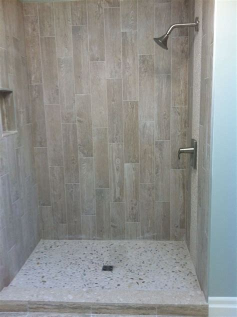 Grey Wood Tile Bathroom by Wood Grain Tile With River Rock Showers