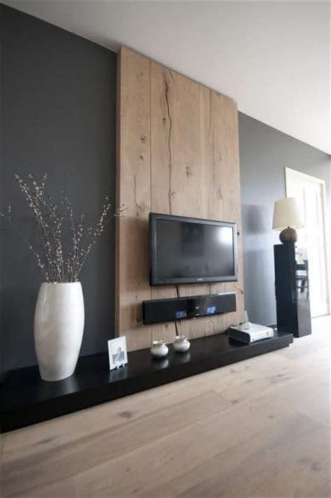 salon moderne et chaleureux avec noir brillant gris
