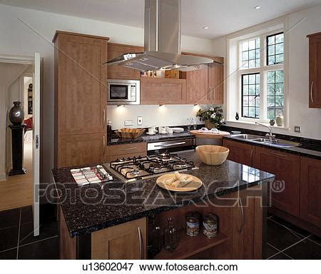modern kitchen island with hob picture of stainless steel extractor above gas hob in