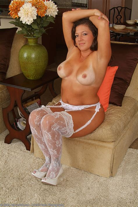 Brunette Milf With Heavy Tits Poses In Her Sexy White