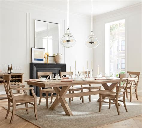 It's crafted with a distressed top and eased edges, and designed to maximize legroom and serving space. Toscana Extending Dining Table - Seadrift | Pottery Barn