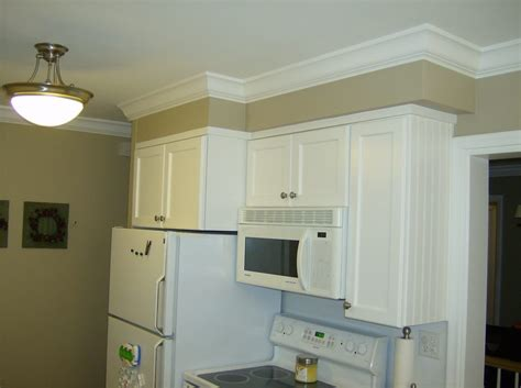 adding moulding to kitchen cabinets we added crown molding to this kitchen custom trim on the 7409