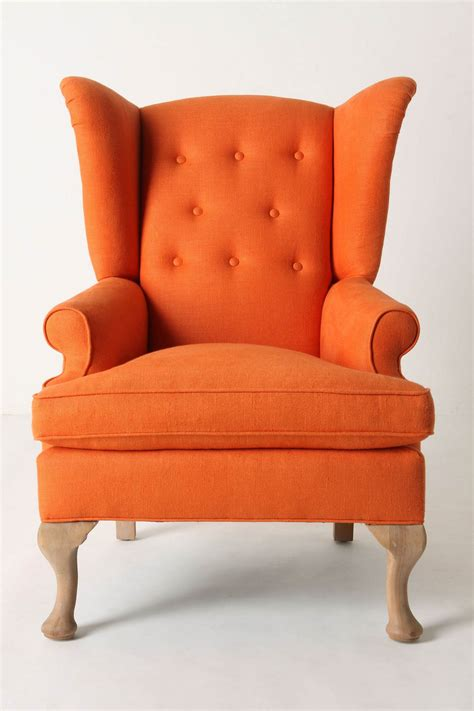 orange fabric wing back chair plus arm rest also