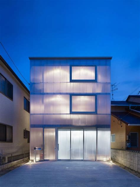 japanese house facade that s a wrap 15 building facades veiled in plastic cloth urbanist
