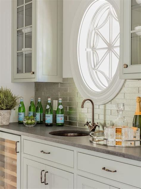 light gray wet bar cabinets  stainless steel backsplash tiles transitional kitchen