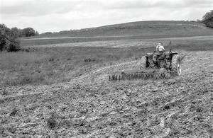 Farmer With Tractor Plowing Field Black And White ...