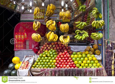 juice stall owner preparing fresh fruit juices editorial