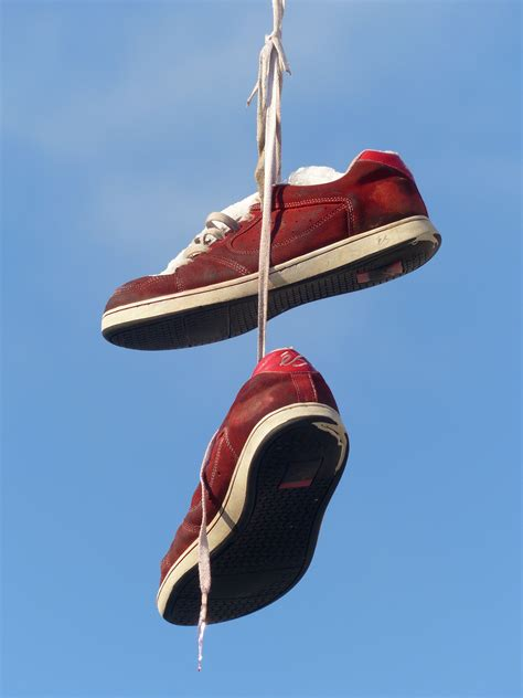 white black high top shoes hanging  electric