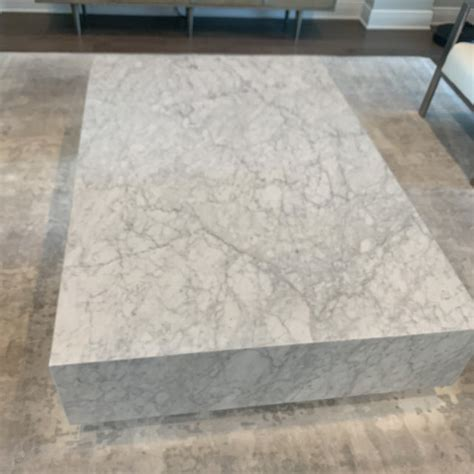 Clad in marble, a tracery of natural veining lends each table unique character, while a low, inset base makes this monumental piece appear to float. Restoration Hardware Marble Plinth Coffee Table | Chairish