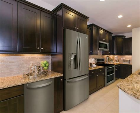 black kitchen cabinets with stainless steel appliances lg s limitless design event celebrating the launch of 9767