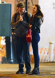 irina shayk kisses bradley cooper in lace up boots