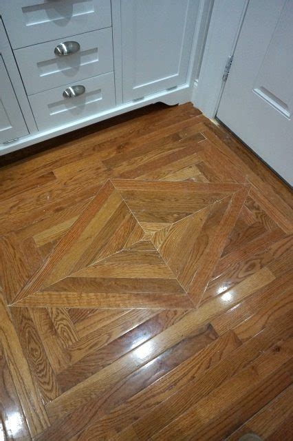 replacing wood floor decorative insert sawdust girl