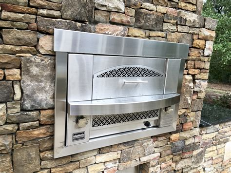 outdoor kitchen built  gas pizza oven fireside