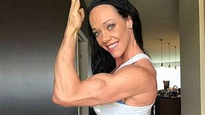 44 years young muscle woman Guinn Field flexing her biceps ...