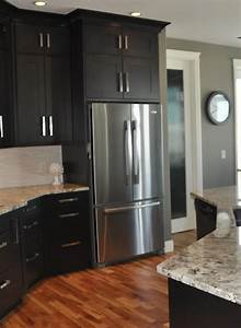 Dark cabinets with gray walls this is what i think