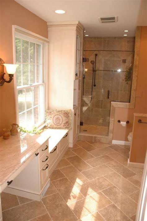 traditional bathroom  light tan tile shower wall