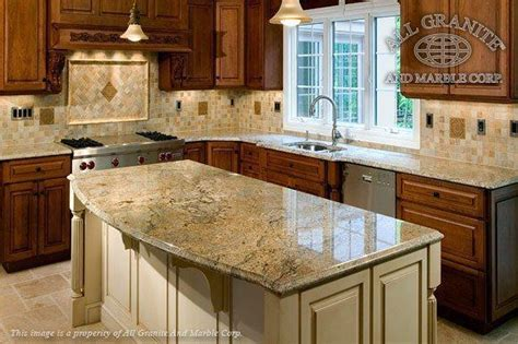 granite countertops with mixed wood cabinets dmarmolinc