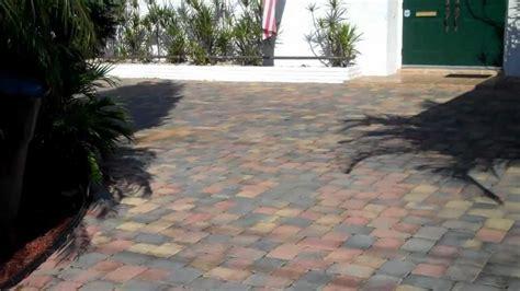 thin pavers concrete driveway vs thick brick pavers