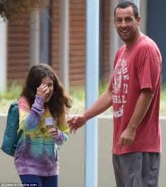 Adam Sandler shows off slimmer physique as he amuses ...