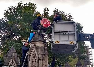 Police lockdown as XR activist climbs Parliament walls and ...