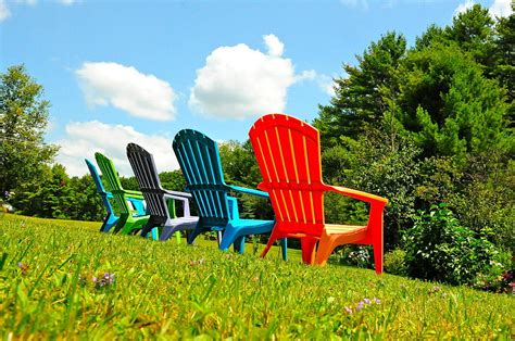 adirondack chairs in bright colors photograph by kevin