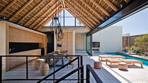 thatched roof house with outdoor entertaining spaces
