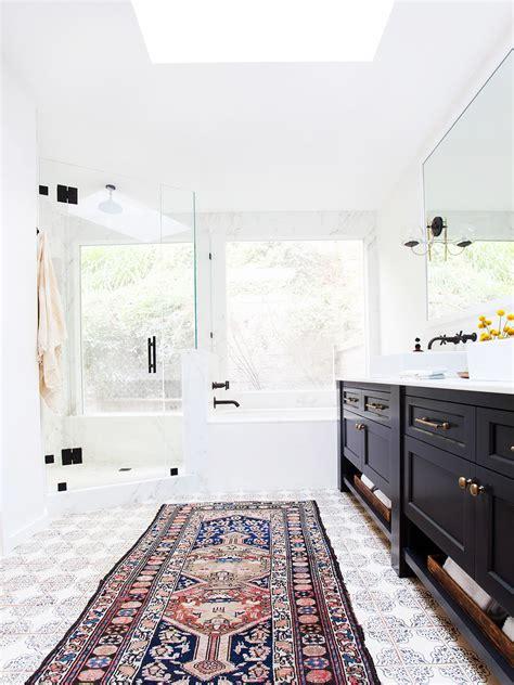 modern white bathroom rugs trend alert rugs in the bathroom mydomaine