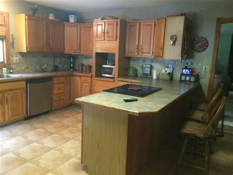 what color should i paint my kitchen cabinets help should i paint the wainscotting on my kitchen walls