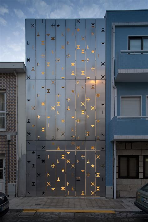 photo perforated building facades that redefine traditional design Facade
