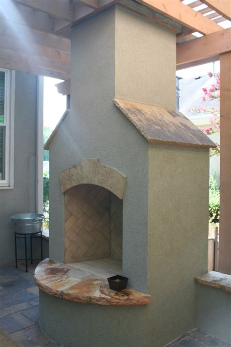 outdoor stucco fireplace stucco fireplace with flagstone accents fireplaces and firepits pinterest arches