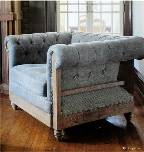hotel size blue fabric and aged wood chesterfield