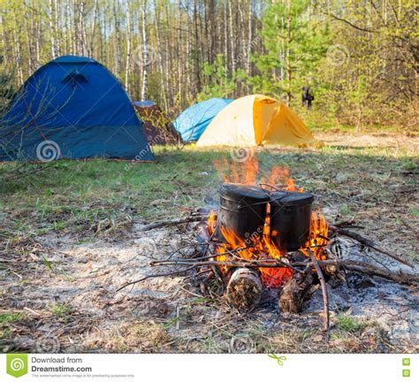 camping fire cooking tent open camp campfire food cauldrons background burning fireplace preview