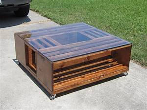 11 diy wooden crate coffee table ideas for Glass top coffee table with wheels